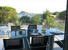 9879-south-beach-style-living-balcony-dining